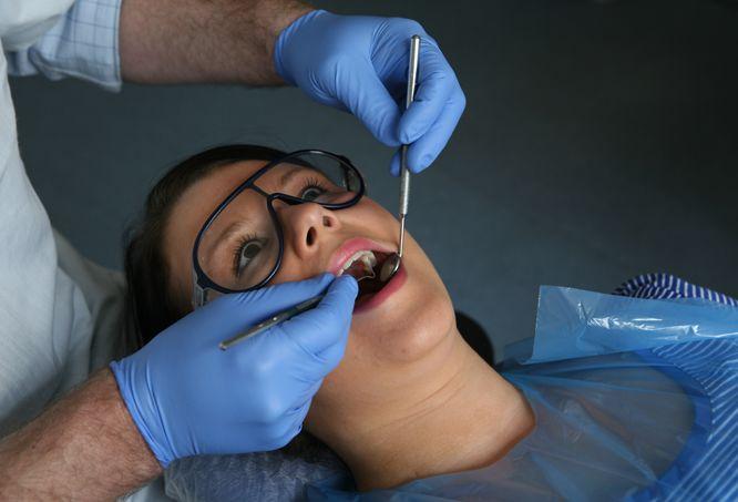 сколько стоит удалить зубной камень